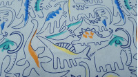 Cotton Strokes Dinosaurs Blue fabric - Cotton fabric with dinosaur drawings in blue strokes on a light blue background. The fabric is 140cm wide and its composition is 100% cotton.