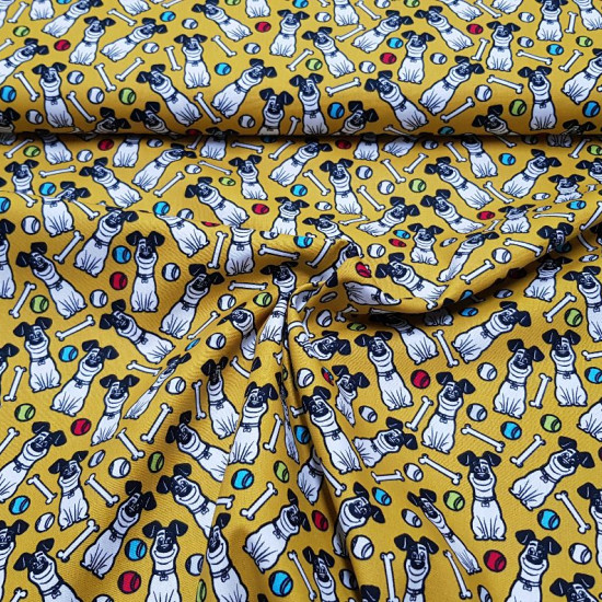 Cotton Pets Max Mustard fabric - Cotton fabric licensed Universal Pictures with drawings of the Max puppy from the movie Pets on a mustard background with bones and colorful balls. The fabric is 150cm wide and its composition is 100% cotton.