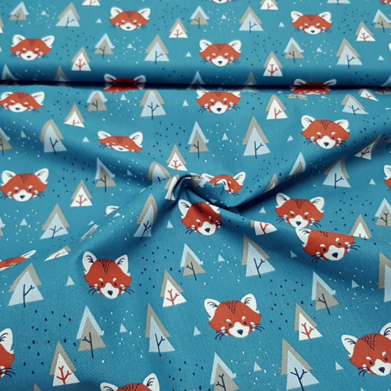 Cotton Foxes and Trees fabric - Children's cotton fabric with drawings of fox faces and trees in Nordic style on an petrol blue background. The fabric is 150cm wide and its composition is 100% cotton.