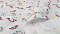 Cotton Unicorn Stars Gray fabric - Children's cotton fabric digitally printed with drawings of unicorns, stars and rainbows on a gray background. The fabric is 150cm wide and its composition is 100% cotton.