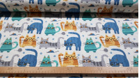 Cretonne Cats and Mice fabric - Cotton cretonne fabric with drawings of cats in blue, gray, green colors... on a white background with mice, footprints and rolls of thread for sewing. The fabric is 150cm wide and its composition is 100% cotton
