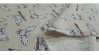 Cotton Harry Potter Owls fabric - Cotton fabric with drawings of the Hedwig owl from Harry Potter on a light background. The fabric is 110cm wide and its composition 100% cotton