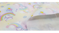 Cotton Hello Kitty Unicorns fabric - Cotton fabric featuring the Hello Kitty cartoon character with unicorns, rainbows, donuts and clouds on a light colored background. The fabric is 150cm wide and its composition is 100% cotton.