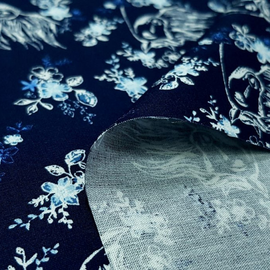Cotton Spirit Horse Floral Navy fabric - Dreamworks licensed cotton fabric with white outline drawings of the Spirit horse on a navy blue background adorned with flowers. The fabric is 150cm wide and its composition is 100% cotton.