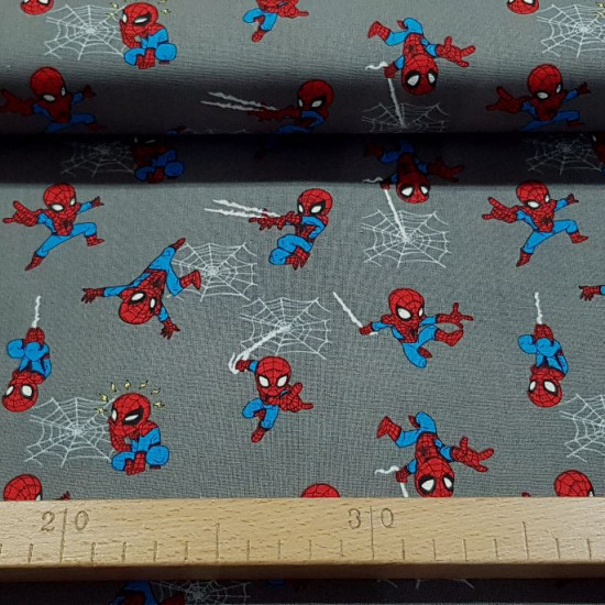 Cotton Marvel Spiderman Mini fabric - Licensed cotton fabric with drawings of Spiderman hanging from cobwebs and somewhat comical, on a gray background. The fabric is 110cm wide and its composition is 100% cotton.