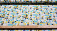 Cotton Minions Grids fabric - Licensed cotton fabric with the characters from the movie Minions on a background of colored squares. The fabric measures between 140-150cm wide and its composition is 100% cotton.
