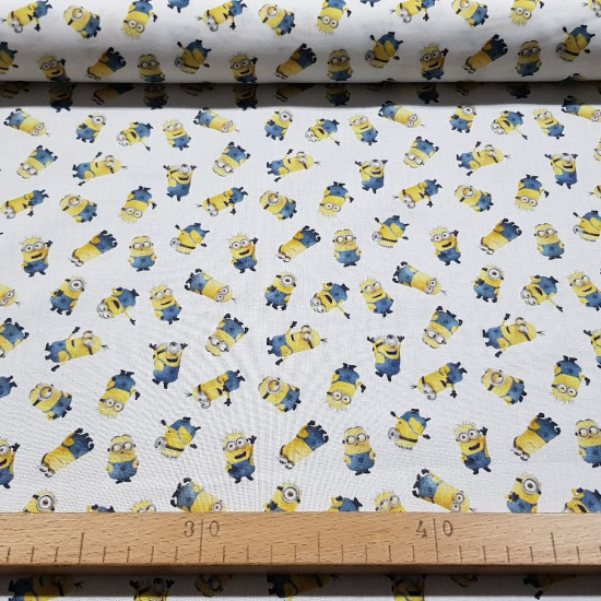 Cotton Minions Allover fabric - Licensed cotton fabric with drawings of the Minions characters on a white background. The fabric measures between 140-150cm wide and its composition is 100% cotton.