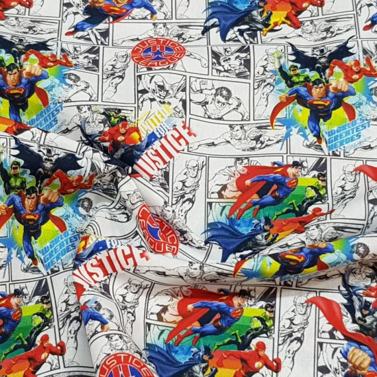 Cotton Justice League United fabric - Licensed cotton fabric with drawings of the Justice League characters, where Superman, Flash, Batman and Green Lantern appear, on a background where comic strips appear. The fabric is 150cm wide and its composition i