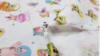 Cotton Spongebob Characters fabric - Licensed cotton fabric with drawings of SpongeBob characters on a white background with colorful polka dots. The fabric measures between 140-150cm wide and its composition is 100% cotton.