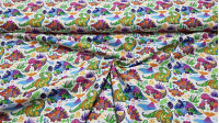 Cotton Colorful Dinosaurs Floral fabric - Digital print cotton fabric with colorful dinosaur drawings and colorful textures on a white background with tropical flowers and volcanoes. A beautiful fabric! The fabric is 150cm wide and its composition is 100%