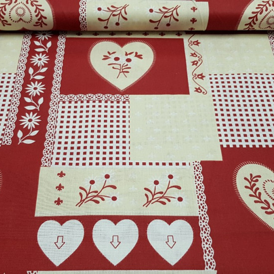 Cotton Christmas Hearts Pictures fabric - Cotton fabric with drawings of hearts of various sizes, squares and plants on a red and cream background. This fabric is ideal for Christmas-themed creations.