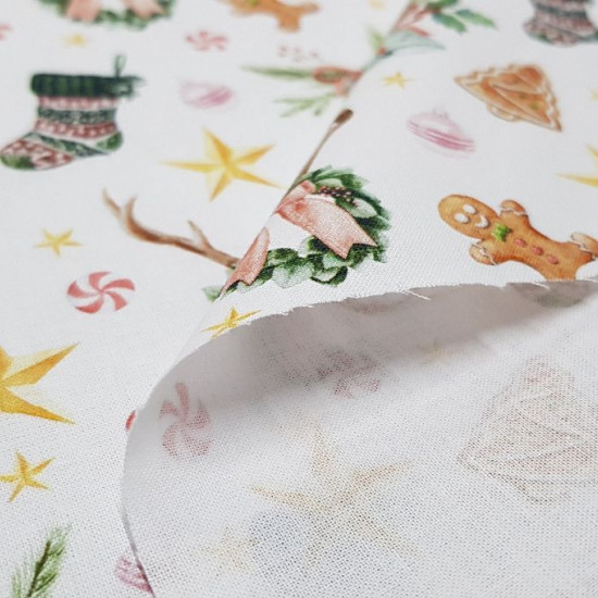 Cotton Christmas Gingerbread Cookies fabric - Christmas-themed cotton fabric featuring drawings of gingerbread cookies, stars, socks and more Christmas ornaments on a white background. The fabric is 150cm wide and its composition 100% cotton
