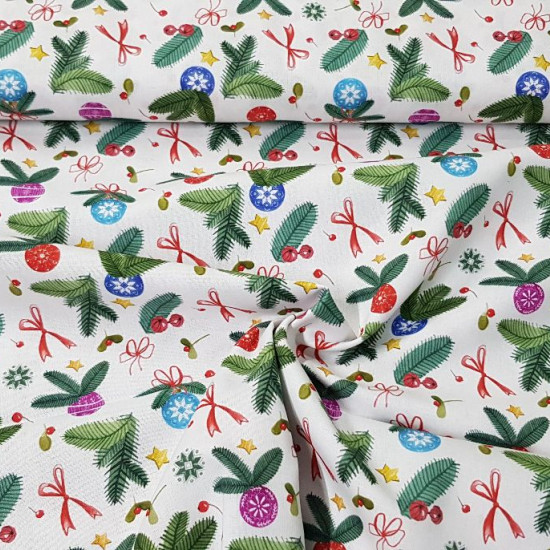 Cotton Christmas Decoration Bows fabric - Organic cotton fabric with Christmas drawings of fir branches, with decorations such as bows, stars, colored balls... The fabric is 150cm wide and its composition is 100% cotton.