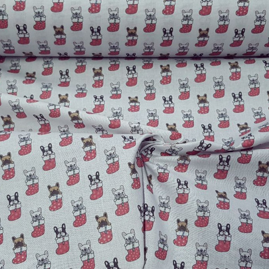 Cotton Christmas Puppies Socks fabric - Cotton fabric digital printing with Christmas drawings of dogs in socks on a light gray background. The fabric is 140cm wide and its composition is 100% cotton.