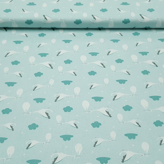 Pique Green Storks fabric - Children's themed pique fabric with drawings of storks and clouds where green and white colors predominate. The pique fabric is ideal for making baby lullabies, sachets, changing tables ... The fabric is 160cm wide a