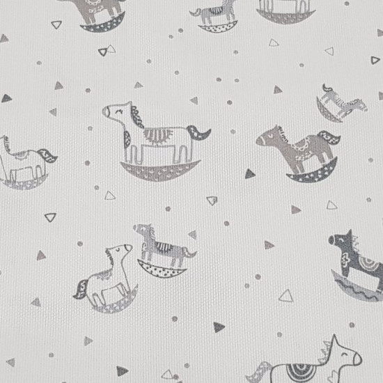 Pique Wooden Horses fabric - Original and beautiful childrens pique fabric with drawings of wooden horses in gray tones, triangles and little tops on a white background. It is an ideal fabric for children's creations, baby like lullabies, bibs, bags