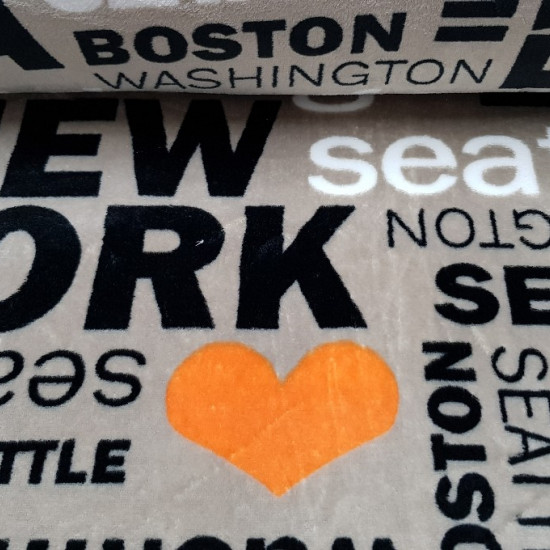 Coral Fleece Love USA fabric - Very soft and warm coral fleece fabric with letters from several cities in the United States (New York, Miami, Chicago, Washington ...) in black and white colors in different sizes and also drawings of orange hearts. All