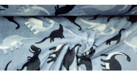 Coral Fleece Double Face Dinosaurs fabric - Coral fleece fabric with different drawings on each side. Dinosaurs appear in one and circles of various sizes appear in the other. The fabric is 150cm wide and its composition is 100% polyester