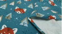 Cotton Jersey Foxes and Trees Blue Petrol fabric - Cotton jersey children's fabric with drawings of faces of foxes and trees Nordic style, with dots simulating the snow on a blue petrol background. The fabric is 150cm wide and its composition 95% cotton -