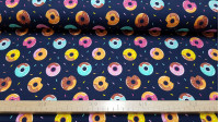 Digital Jersey Donuts Navy Blue fabric - Digital print cotton jersey fabric with colorful donut drawings on a navy blue background and colorful noodles. The fabric is 150cm wide and its composition is 94% cotton - 6% elastane.