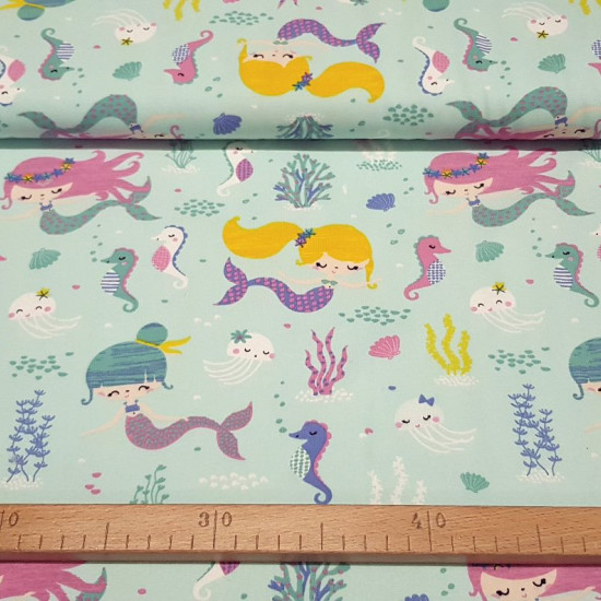 Cotton Jersey GOTS Sirens fabric - Organic cotton jersey fabric (GOTS) with drawings of little mermaids, seahorses, jellyfish... on a light colored background. The fabric is 160cm wide and its composition is 95% cotton - 5% elastane