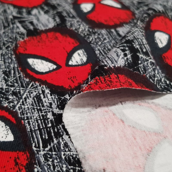 Cotton Jersey Spiderman Mask fabric - Licensed cotton jersey fabric with drawings of the Spiderman mask and cobwebs forming a mosaic. The fabric is 150cm wide and its composition is 92% cotton - 8% elastane