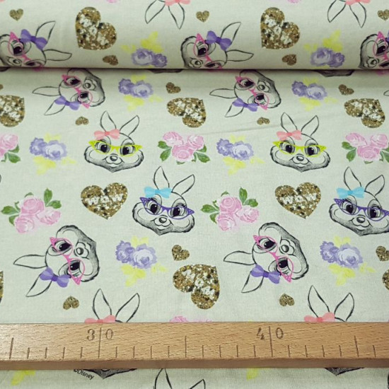 Cotton Jersey Thumper Bambi fabric - Licensed cotton jersey fabric featuring drawings of the character Thumper from the Disney movie Bambi with glasses and bows on a light background with hearts and roses. The fabric is 160cm wide and its comp