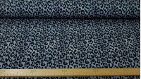 Jersey Animal Print Jeans Gray fabric - Cotton jersey fabric, with an animal print pattern in gray tones, jeans style. The fabric is 150cm wide and its composition is 95% cotton - 5% elastane. T-shirt knit fabric is widely used in making children's clo