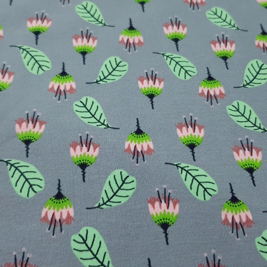 Jersey Leaves Flowers fabric - Cotton jersey fabric with drawings of flowers and leaves on a gray background. The fabric is 150cm wide and its composition is 95% cotton - 5% elastane. T-shirt knit fabrics are widely used in the manufacture of