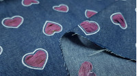 Denim Fine Hearts fabric - Fine cotton denim fabric with openings in heart patterns, practically exposed. The fabric is 150cm wide and its composition is 100% cotton