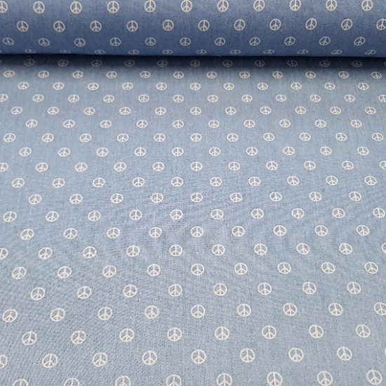 Denim Hippie fabric - Fun fine denim fabric with white hippie peace and love symbols on a light denim background. Very cool accessories can be created with this denim fabric, as well as garments such as skirts, pants and much more. The co