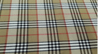 Viella Scottish CheckBeige fabric - Viella fabric with Scottish check in beige and brown Burberry style. The fabric is 150cm wide and its composition 65% polyester - 35% viscose