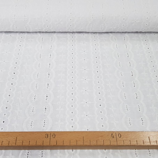 Embroidered Cotton Tika fabric - Beautiful embroidered and perforated cotton batiste fabric in white with floral motifs. The fabric is 135cm wide and its composition is 100% cotton.