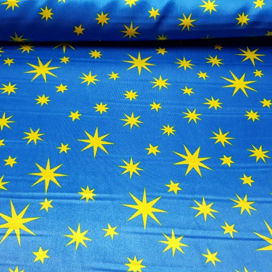Satin Stars Merlin fabric - Satin fabric, bright on one side and with a lot of fall. Stamped with yellow stars on a blue background. Ideal for magician costume.