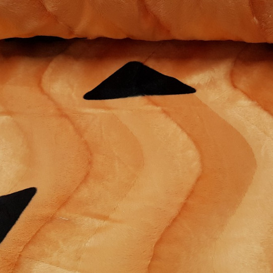 Velboa Flinstones Print fabric - Soft velboa hair fabric with drawings of black shapes on an orange background, typical of Flintstones costumes. The fabric measures 150cm wide and its 100% polyester composition.