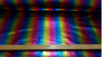 Lycra Bright Rainbow fabric - Elastic and bright lycra fabric with a multicolored pattern imitating the rainbow. A great fabric for costumes with a lot of brightness and for dance or rhythmic gymnastics, for example. The fabric is 150cm wide and