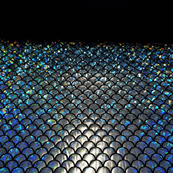 Lycra Silver Scales fabric - Elastic black lycra fabric with silver scale laminate making hologram effect. It is an ideal fabric for carnival, dance and sport dresses. The fabric is 150cm wide and its composition 92% polyester - 8% spandex.