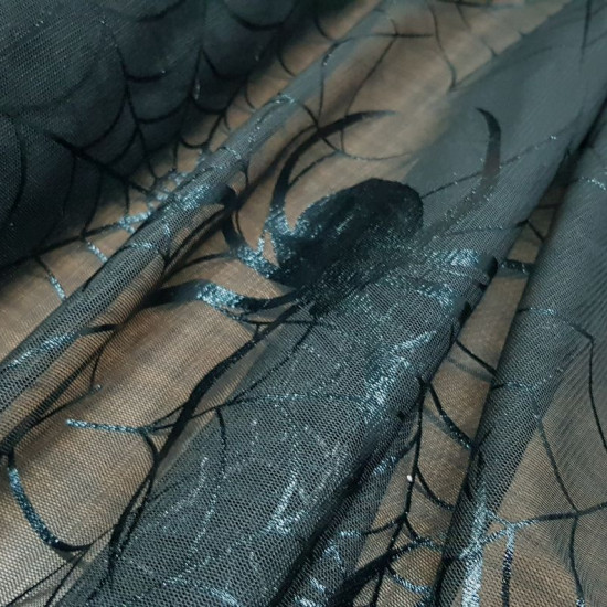 Large Spiderweb Net fabric - Semi-transparent fabric of soft black net with spider web designs with its spider. It is the ideal fabric for witch costumes, Halloween and decoration. The fabric is 145cm wide and its composition 100% polyester