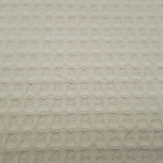 Waffle Standard fabric - Waffle fabric Oekotex cotton. The waffle fabric is characterized by its squares in relief making the shape of a waffle or honeycomb. It is widely used in children's clothing and home. The fabric is 150cm wide and its