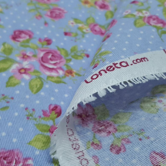 Canvas Roses and Polka Dots Blue fabric - Beautiful patterned canvas fabric. Strong and resistant fabric ideal for decoration and upholstery. This patterned canvas fabric has a width of 280cm and makes it special for large jobs. The drawing of this fabric