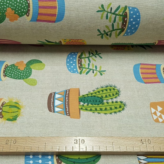 Canvas Rustic Cactus fabric - Canvas fabric ideal for home decoration with drawings of cactus in pots of different types on a rustic background. The fabric is 280cm wide and its composition is 50% cotton - 50% polyester.