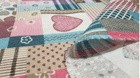 Canvas Patch Hearts fabric - Decorative canvas fabric with drawings of hearts and panels making patchwork where pink and blue colors predominate. The fabric is 280cm wide and its composition is 70% cotton - 30% polyester