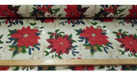 Canvas Christmas Poinsettia fabric - Decorative Christmas-themed canvas fabric where drawings of the Christmas flower, also called poinsettia, appear on a light background with golden letters. The fabric is 280cm wide and its composition is 70% cotton -