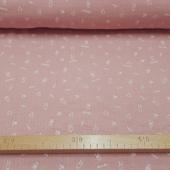"Double Gauze RocknRoll Pale Pink fabric - Double gauze or cotton muslin fabric with drawings of hands, rays and ""Rock'n'Roll"" phrases in white lines on a pale pink background. The fabric is 130cm wide and its composition is 100% cotton."