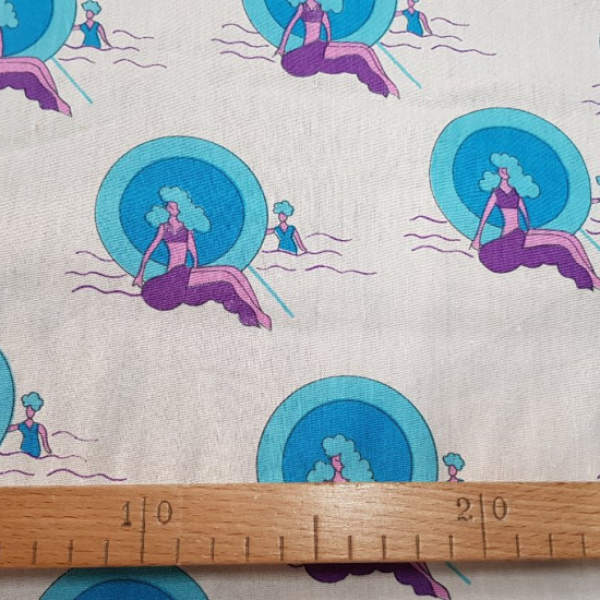 OUTLET Mermaids in the sea fabric - Cotton fabric with drawings of mermaids in the sea on a white background The fabric is 115cm wide and its composition is 100% cotton.