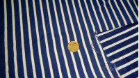 Crepe White Blue Striped fabric - Crepe fabric printed with white stripes on a dark blue background. The size is medium.